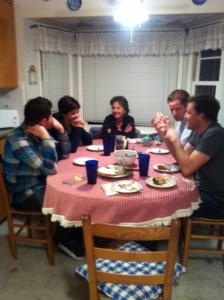 My mom in her natural habitat: the dinner table surrounded by her children.